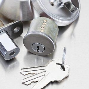 Silver door knob lock and keys on table
