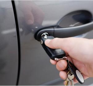 A locksmith opens a car door in Perth