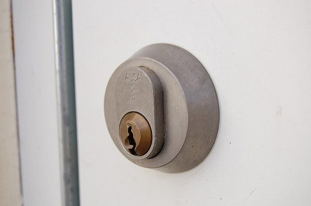 Silver Door Lock on Locked White Door